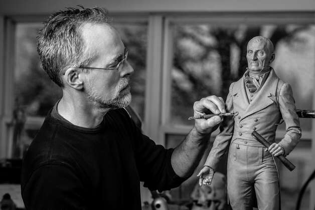 Sculptor Patrick Pigott works on a maquette of Troy's first mayor, Col. Albert Pawling, in his Halfmoon studio with the eventual goal of erecting a seven-foot statue on Congress Street in time for bicentennial of the city's incorporation in 2016. The maquette, or a preliminary model, which is phase I of the project, is now completed.  (Photo by Leise Lee)