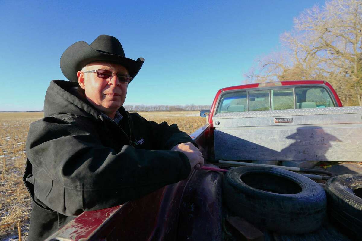 FILE - In this Jan. 16, 2015 file photo, Ken Prososki, who opposes the Keystone XL pipeline, leans against his pickup along the route of the pipeline which is planned to go through his property, in Fullerton, Neb. Officials with TransCanada said Tuesday, Jan. 20, 2015, they've filed paperwork in nine counties to acquire access to land that's needed for the construction and operation of the pipeline. The route still faces challenges as opponents have filed lawsuits to try to prevent the Calgary, Alberta-based company from using eminent domain and to overturn the state law that allowed ex-Gov. Dave Heineman to approve the route. (AP Photo/Nati Harnik, File)