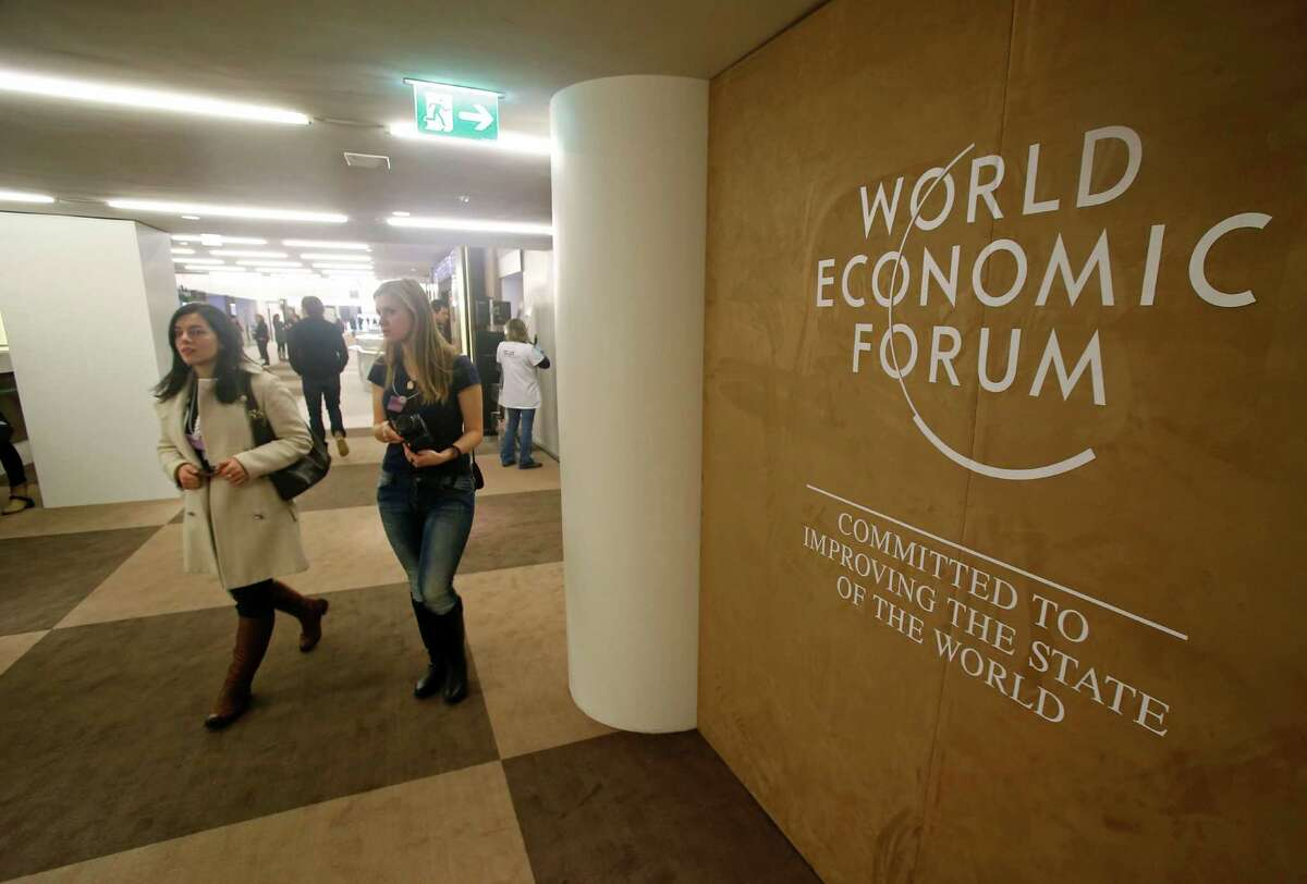 People walk inside the Congress Hall in Davos, Switzerland, on Monday, Jan. 19, 2015.