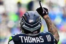 Earl Thomas extends a finger to the heavens during the first half of the NFC Championship game against the Green Bay Packers Sunday, January 18, 2015, at CenturyLink Field in Seattle, Washington.