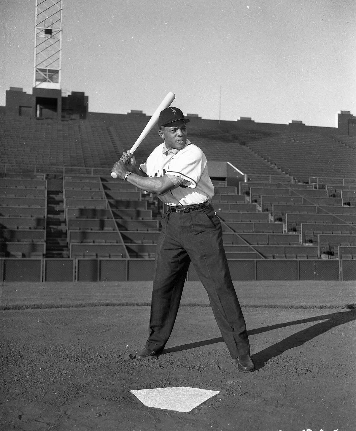 Willie Mays posing at the plate in Seals Stadium during an October 31, 1957 photo shoot, the year before the outfielder made his debut as a San Francisco Giant.