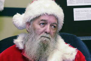 Ed Hilton, the retired South End Santa, attends a party to commemorate 30 years of bringing joy to the kids in Albany's South End, Dec. 21, 2002. (James Goolsby/Times Union archive)
