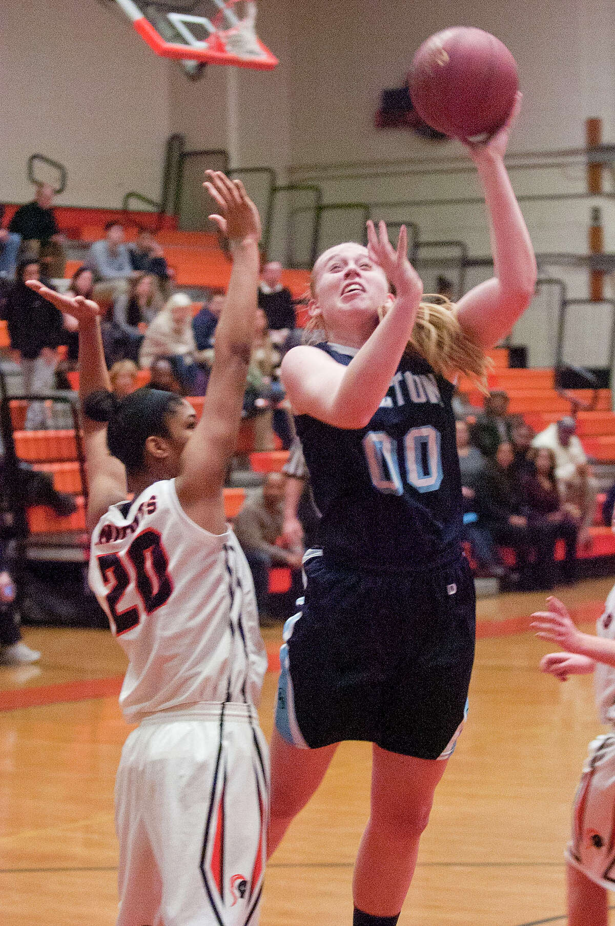Wilton's Erica Meyer puts up a shot over Stamford's Marthe Guirand during their basketball game at Stamford High School in Stamford, Conn., on Tuesday, Jan. 20, 2015. Wilton won, 52-35.
