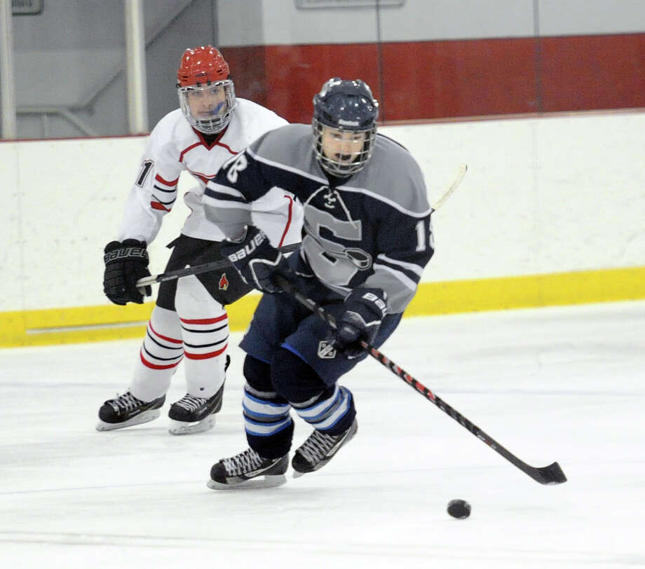 FILE — At right, Ryan Purgay, # 18 of Staples-Weston-Shelton, leads a break while being trailed by Brian Silard of Greenwich, at left, during the boys high school ice hockey game between Greenwich High School and the Staples-Weston-Shelton combined team at Hamill Rink, Greenwich Conn., Tuesday, Jan. 20, 2015. Greenwich won the game, 8-3. Photo: Bob Luckey / Greenwich Time