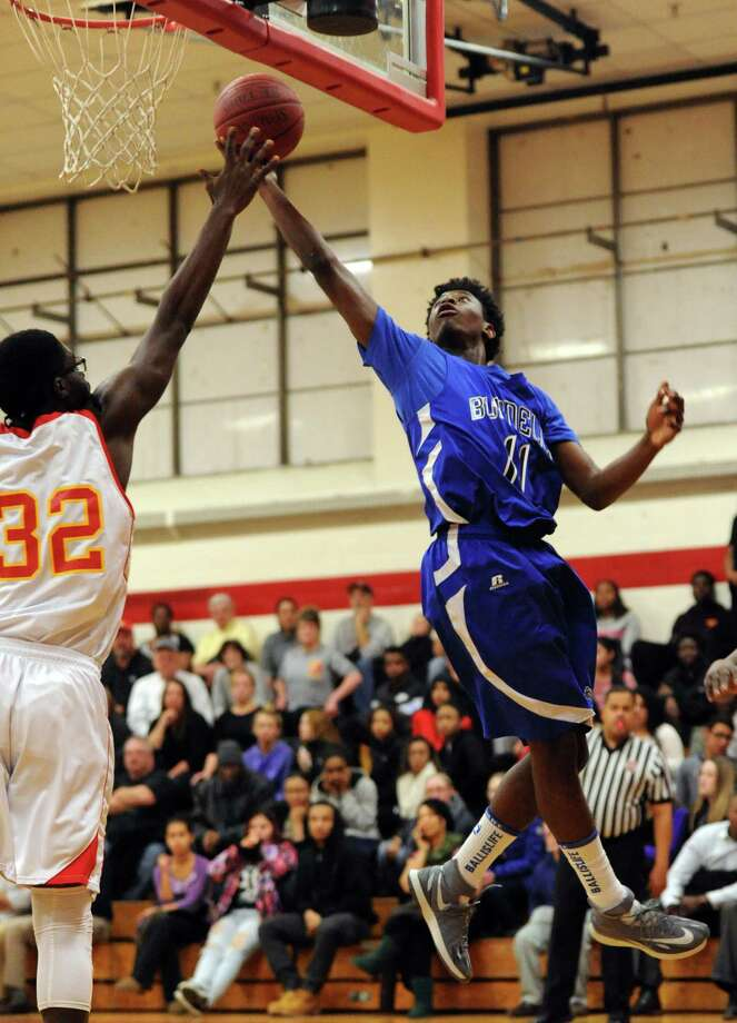 Bunnell's Aaron Samuel takes a shot as Stratford's #32 defends during their game against Stratford Tuesday, Jan. 20, 2015 at Stratford High School. Photo: Autumn Driscoll / Connecticut Post