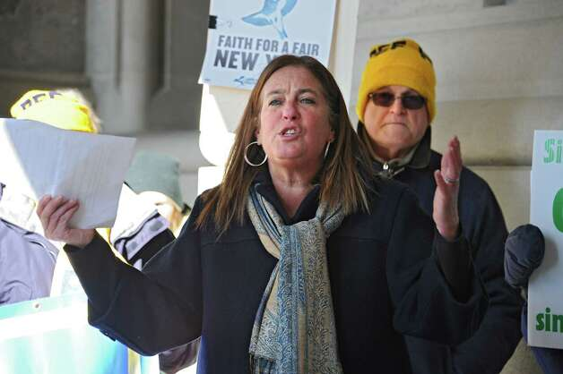 New Paltz Town Supervisor Susan Zimet expresses her concerns about education and the poor at the 25th Annual People's State of the State rally at the Capitol on Tuesday, Jan. 20, 2015 in Albany, N.Y.  (Lori Van Buren / Times Union) Photo: Lori Van Buren / 00030268A