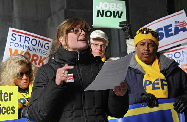 Citizen Action of New York speaker Jessica Wisneski of Olive Bridge, N.Y. expresses her concerns at the 25th Annual People's State of the State rally at the Capitol on Tuesday, Jan. 20, 2015 in Albany, N.Y.  (Lori Van Buren / Times Union) Photo: Lori Van Buren / 00030268A