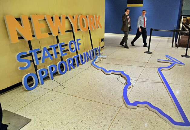 Signage for Wednesday's State of the State address and budget presentation is readied outside the Convention Center Tuesday Jan. 20, 2015, at the Empire State Plaza in Albany, NY.  (John Carl D'Annibale / Times Union) Photo: John Carl D'Annibale