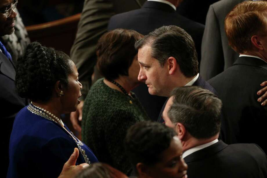 Texas' Republican Sen. Ted Cruz chats with Democratic Rep. Sheila Jackson Lee of Houston on the floor of the House Chamber, before the State of the Union Address Tuesday night. Democrats said Obama was paving the way for a starting point for talks, while Republicans said Obama's ideas already have been rejected.  Photo: DOUG MILLS, STF / NYTNS