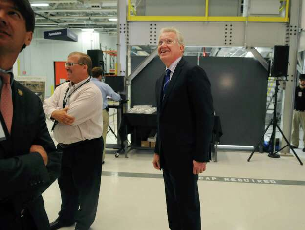 In this archive photo, Jeffrey Immelt, GE chairman and CEO, looks over the battery manufacturing floor during a tour during the opening of the company's new battery plant on Tuesday, July 10, 2012 at the GE campus in Schenectady, NY.  (Paul Buckowski / Times Union archive) Photo: Paul Buckowski / 00018395A