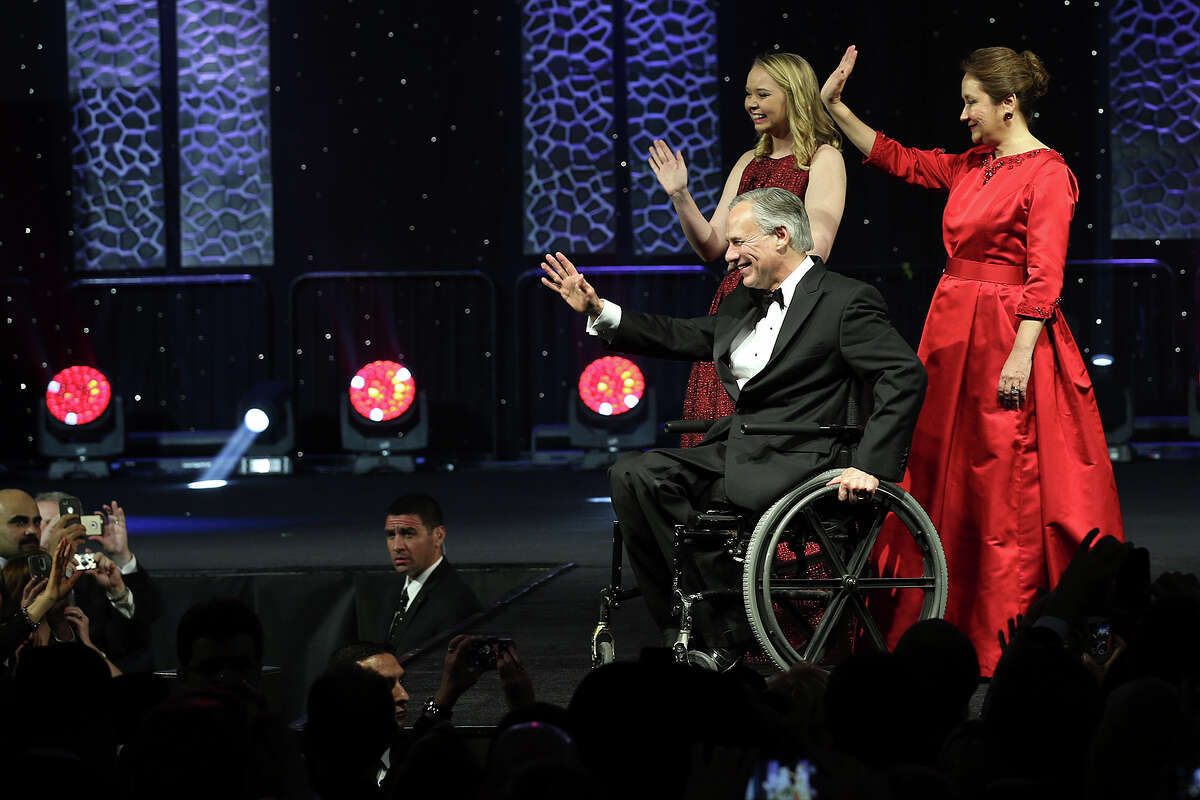 Governor Greg Abbott, his wife, Cecilia and daughter, Audrey, wave at the crowd during the Texas Inauguration 2015 Future of Texas Ball at the Austin Convention Center, Tuesday, Jan. 20, 2015. Abbott will serve as the 48th governor of the State of Texas. A crowd of 10,000 was expected to attend the event.