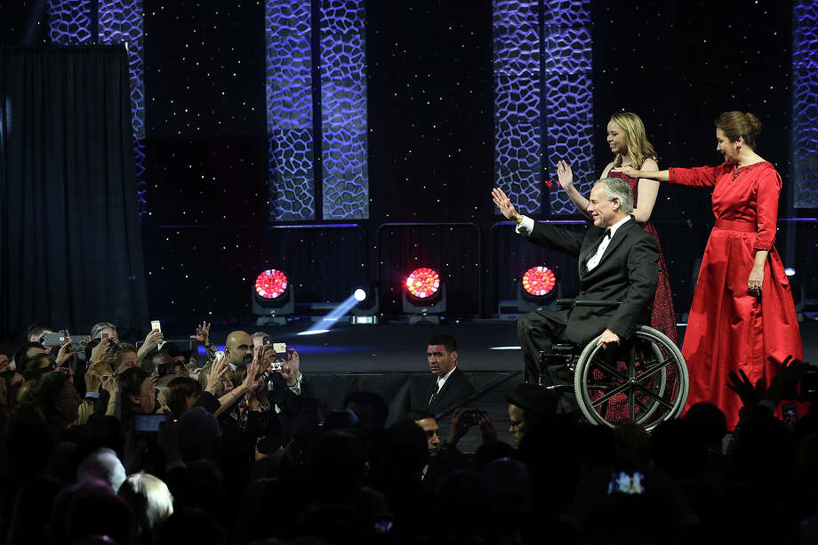 Governor Greg Abbott, his wife, Cecilia and daughter, Audrey, wave at the crowd during the Texas Inauguration 2015 Future of Texas Ball at the Austin Convention Center, Tuesday, Jan. 20, 2015. Abbott will serve as the 48th governor of the State of Texas. A crowd of 10,000 was expected to attend the event. Photo: JERRY LARA, San Antonio Express-News / © 2015 San Antonio Express-News
