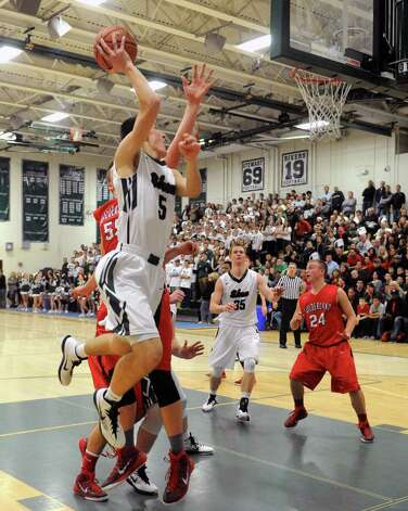 Shen's Thomas Huerter drives to the basket during their boy's high school basketball game against Guilderland on Tuesday Jan. 20, 2015 in Clifton Park, N.Y. (Michael P. Farrell/Times Union) Photo: Michael P. Farrell / 00030265A