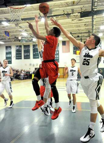 Guilderland's Michael Wine drives to the basket during their boy's high school basketball game against Shenendehowa on Tuesday Jan. 20, 2015 in Clifton Park, N.Y. (Michael P. Farrell/Times Union) Photo: Michael P. Farrell / 00030265A
