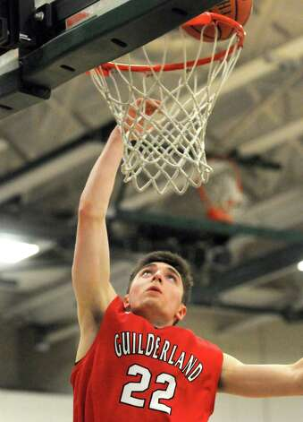 Guilderland's Andrew Platek goes in for a score during their boy's high school basketball game against Shenendehowa on Tuesday Jan. 20, 2015 in Clifton Park, N.Y. (Michael P. Farrell/Times Union) Photo: Michael P. Farrell / 00030265A