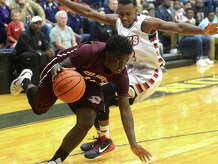 Hardin-Jefferson's Dylan Mays pressures Silsbee's Dontre' Thomas as he drives toward the basket during Tuesday night's game in Sour Lake.  Photo taken Tuesday, January 20, 2015  Kim Brent/The Enterprise