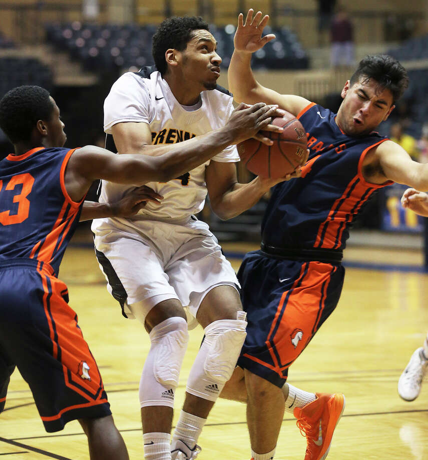 Jordan Murphy fights into position for the Bears against Jakobe Jones (13) and Erick Reynoso (44) as Brennan plays Brandeis at Greehey Arena on January 20, 2015. Photo: Tom Reel, San Antonio Express-News