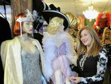 Sophia Scarpelli, owner of Sophia's Costumes in Greenwich, Conn., Tuesday, Jan. 20, 2015, with vintage costumes from the Roaring Twenties displayed on mannequins at her store. The authentic and vintage costume shop is located at 1 Liberty Way in central Greenwich and has been in business for over 30 years.