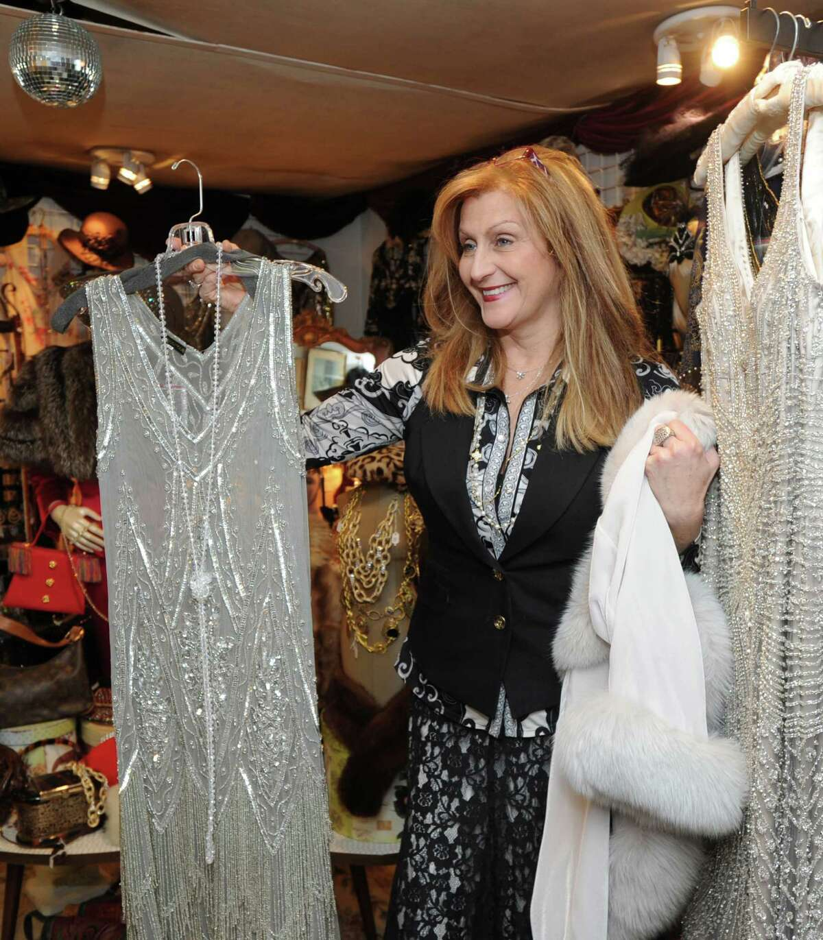 Sophia Scarpelli, owner of Sophia's Costumes in Greenwich, Conn., Tuesday, Jan. 20, 2015, displays an authentic flapper dress at her store. The authentic and vintage costume shop is located at 1 Liberty Way in central Greenwich and has been in business for over 30 years.