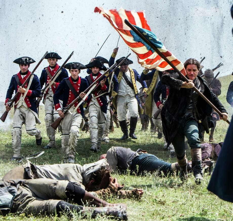 "In this 2014 photo released by the History Channel, actors portray Revolutionary War soldiers in a scene from ""Sons of Liberty,"" a new miniseries premiering in January 2015 on the History Channel. (AP Photo/History Channel, Ollie Upton) Photo: Ollie Upton, HONS / History Channel"