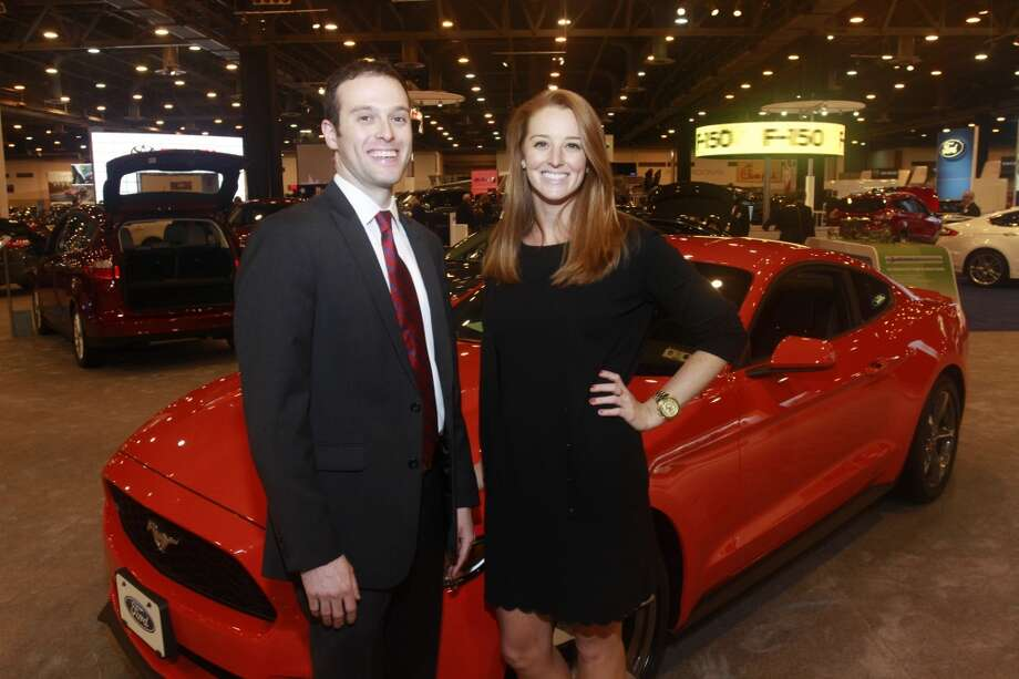 Tony Bossard and Caitlin Saxton in front of a 2015 Ford Mustang at the Houston Auto Show Boots & Suits Preview Night Party. (For the Chronicle/Gary Fountain, January 20, 2015) Photo: Photography Gary Fountain