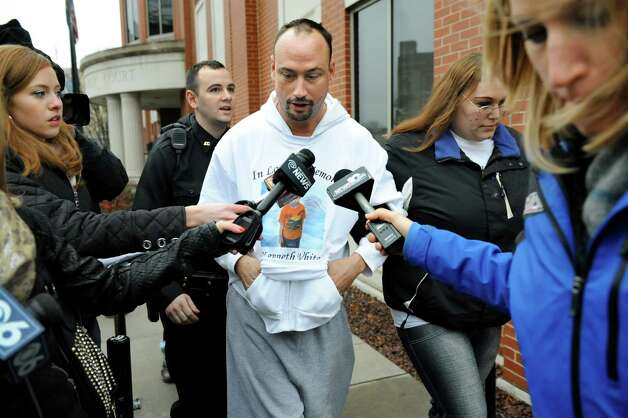 Jayson White, center, is hounded by the media after being denied custody of his two daughters, ages 5 and 4, on Tuesday Dec. 23, 2014, at Albany County Family Court in Albany, N.Y. White is the father of the late 5-year-old slaying victim Kenneth White, and the girls are Kenneth's sisters. (Cindy Schultz / Times Union) ORG XMIT: MER2015012111184261 Photo: Cindy Schultz / 00029969A