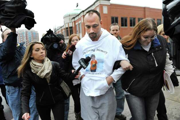Jayson White, center, is hounded by the media after being denied custody of his two daughters, ages 5 and 4, on Tuesday Dec. 23, 2014, at Albany County Family Court in Albany, N.Y. White is the father of the late 5-year-old slaying victim Kenneth White, and the girls are Kenneth's sisters. (Cindy Schultz / Times Union) ORG XMIT: MER2015012111182460 Photo: Cindy Schultz / 00029969A