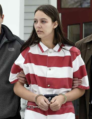 Tiffany VanAlstyne, 19, is escorted out of Knox Town Court Friday afternoon, Dec. 19, 2014, in Knox, N.Y., where she was arraigned on 2nd degree murder charges for the alleged strangulation death of her cousin, 5-year-old Kenneth White. The teenager pleaded not guilty. She was sent to the Albany County jail without bail. (Skip Dickstein/Times Union) ORG XMIT: MER2014122004571401 Photo: SKIP DICKSTEIN