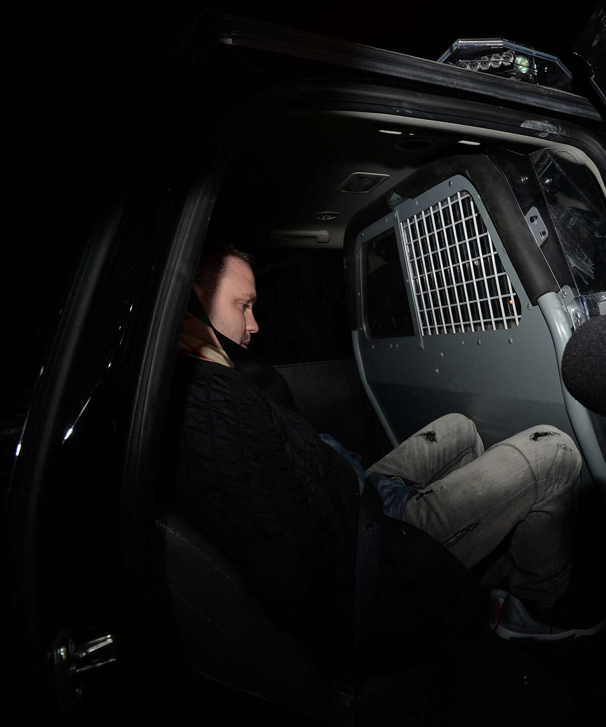 Adam Fuller is taken into custody after being arrested for a parole violation Tuesday. Fuller is charged with capital murder. Tuesday, January 20, 2015 Kim Brent/The Enterprise