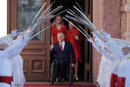 Texas Gov.-elect Greg Abbott, center, arrives for his inauguration with his wife, Cecilia, right, and daughter, Audrey, left, Tuesday, Jan. 20, 2015, in Austin, Texas. Abbott is the first Texas governor to use a wheelchair.