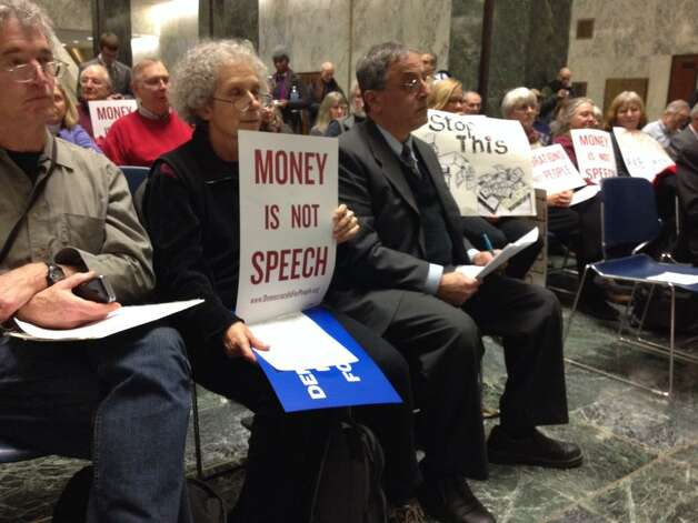 Supporters of campaign finance reforms listen to a speech before Gov. Andrew Cuomo delivered his State of the State address on Wednesday, Jan. 21, 2015. (John Carl D'Annibale / Times Union)