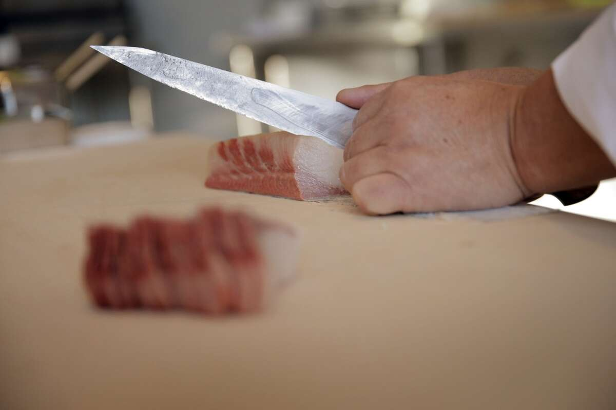 Fresh fist being prepared at the Sushi and Oyster Bar at The Market.