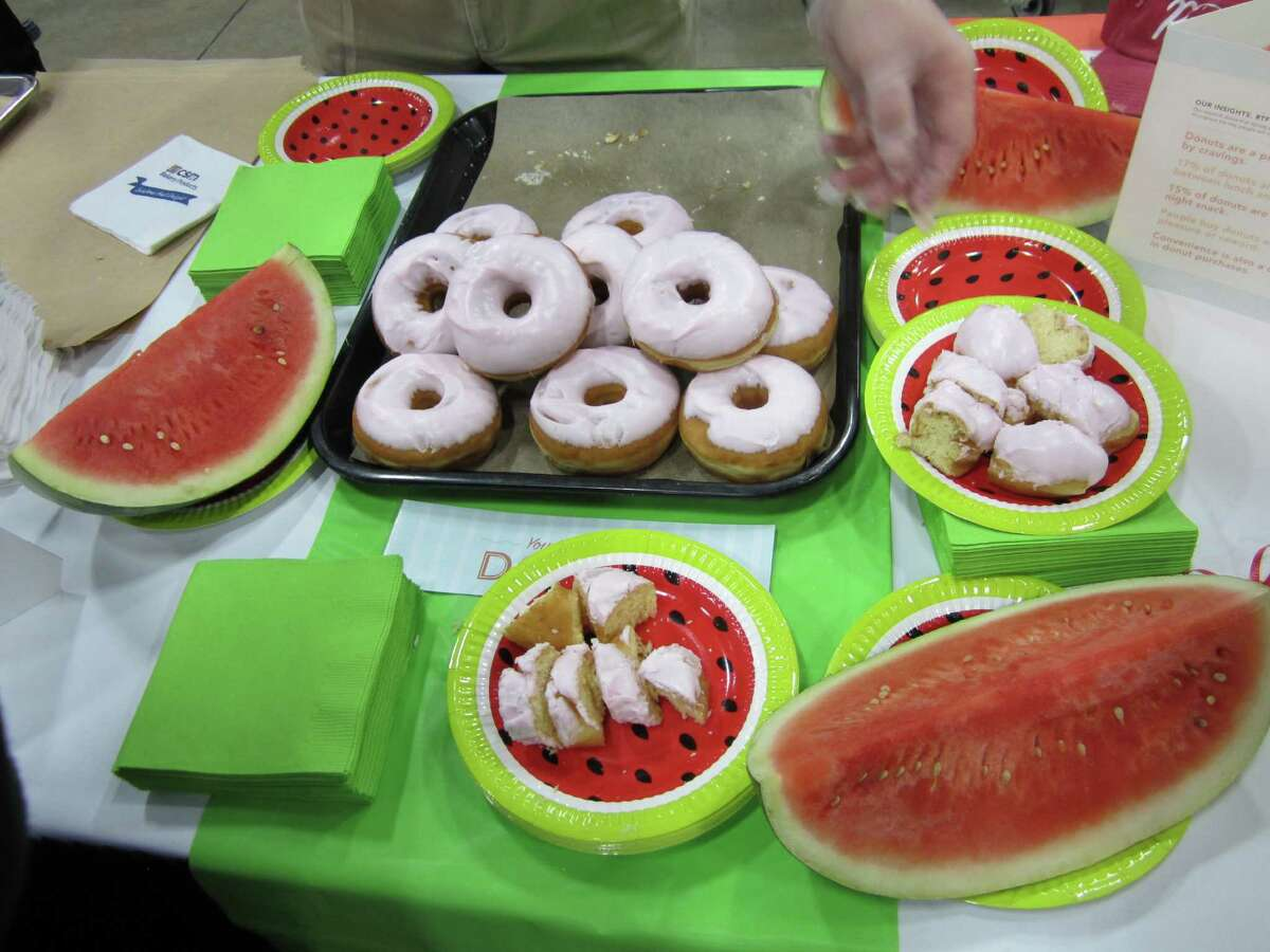 Vendors offer samples of a watermelon glaze donut at a trade show that CST Brands Inc. hosted on Tuesday for store managers to localize their merchandise mix.