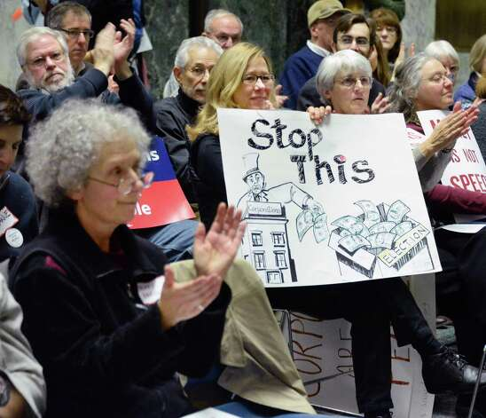 Supporters applaud during a pro-democracy rally to rein in campaign spending at the Legislative Office Building Wednesday January 21, 2015 in Albany, NY.   (John Carl D'Annibale / Times Union) Photo: John Carl D'Annibale / 00030240B