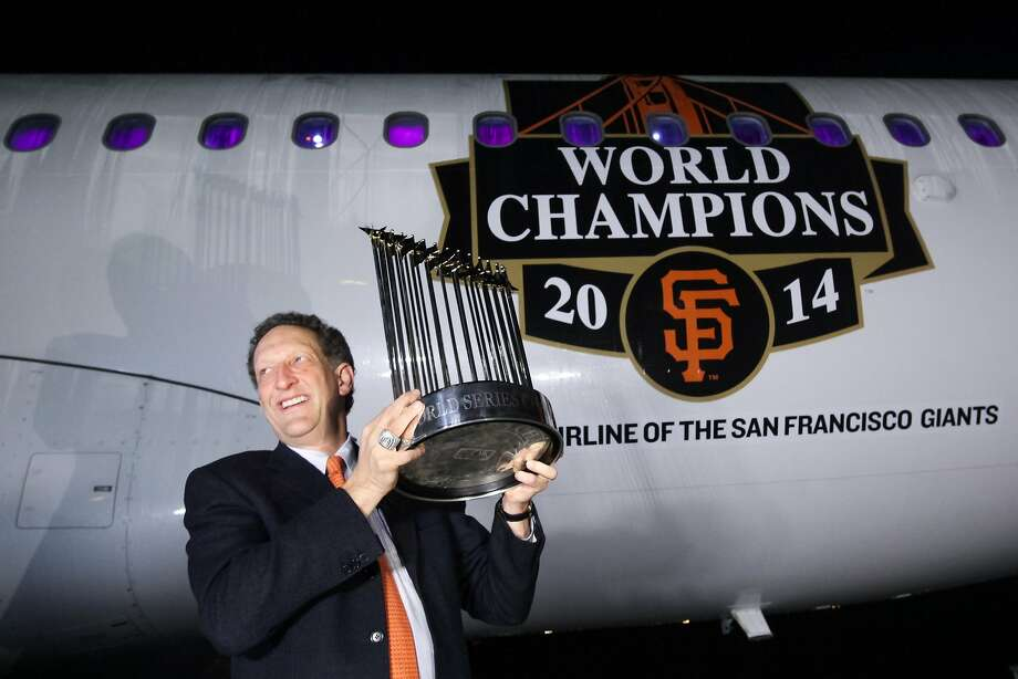San Francisco Giants CEO Larry Baer poses in front of a Giants-branded Virgin America plane. Photo: Santiago Mejia, The Chronicle