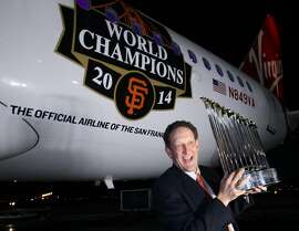 San Francisco Giants CEO Larry Baer pictured with the World Series trophy outside a Virgin America plane, Wednesday, Jan. 21, 2015, at the San Francisco International Airport. The plane is headed towards New York where the trophy continues its course in the World Champions Trophy Tour.