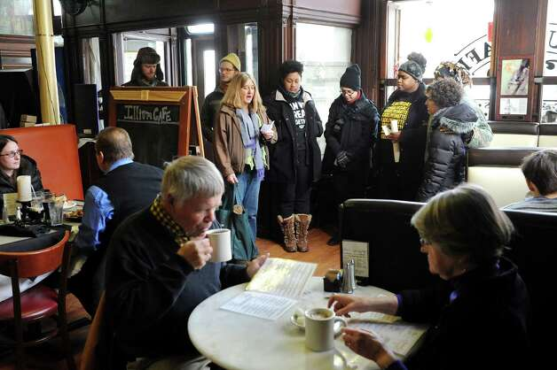 Blue Carreker, third from left, joins activists with Capital Area Against Mass Incarceration as they spread the message that black lives matter on Saturday, Jan. 17, 2015, at Illium Cafe in Troy, N.Y. (Cindy Schultz / Times Union) Photo: Cindy Schultz / 00030246A