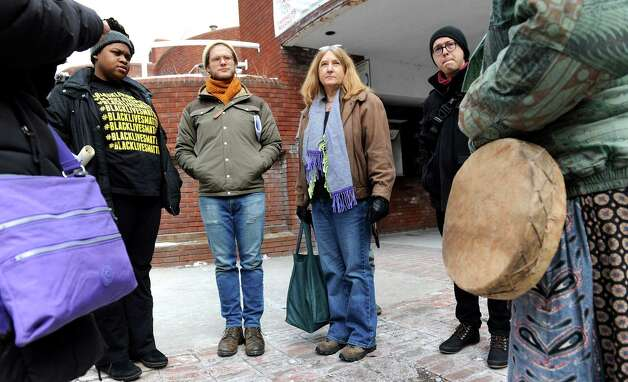 Blue Carreker, center, joins activists with Capital Area Against Mass Incarceration as they spread the message that black lives matter on Saturday, Jan. 17, 2015, in Troy, N.Y. (Cindy Schultz / Times Union) Photo: Cindy Schultz / 00030246A