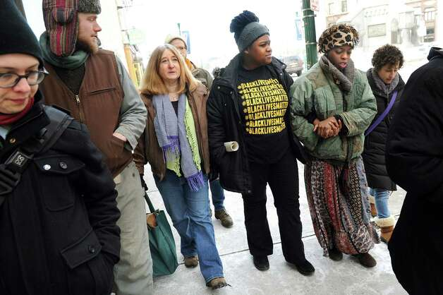 Blue Carreker of Scotia, third from left, joins Sophia Smart of Rensselaer, center, Amani Olugbala of Albany and other activists with Capital Area Against Mass Incarceration as they spread the message that black lives matter on Saturday, Jan. 17, 2015, in Troy, N.Y. (Cindy Schultz / Times Union) Photo: Cindy Schultz / 00030246A