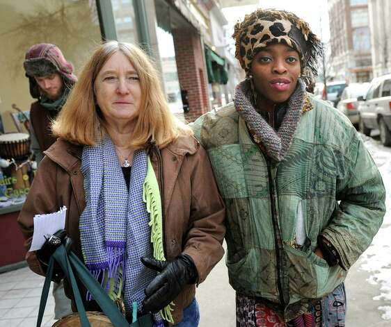 Blue Carreker of Scotia, left, and Amani Olugbala of Albany join other activists with Capital Area Against Mass Incarceration as they spread the message that black lives matter on Saturday, Jan. 17, 2015, in Troy, N.Y. (Cindy Schultz / Times Union) Photo: Cindy Schultz / 00030246A