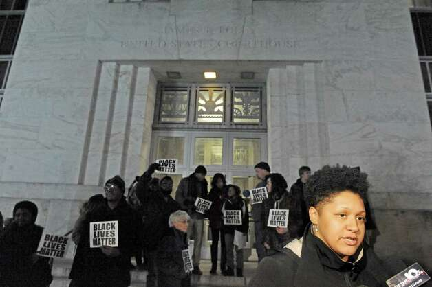 Angelica Clarke, right, of Troy talks with the media after she and other activist delivered papers to the US Attorney's Office Northern District of New York at the James T. Foley United States Courthouse on Friday Dec. 5, 2014 in Albany, N.Y.  (Michael P. Farrell/Times Union) Photo: Michael P. Farrell / 00029765A
