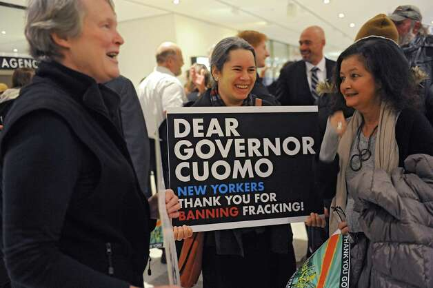 Singer-songwriter and activist Natalie Merchant, center, was among many people holding signs thanking Governor Andrew Cuomo for banning fracking before his State of the State address in the Convention Center at the Empire State Plaza on Wednesday, Jan. 21, 2015 in Albany, N.Y.  (Lori Van Buren / Times Union) Photo: Lori Van Buren / 00030240A