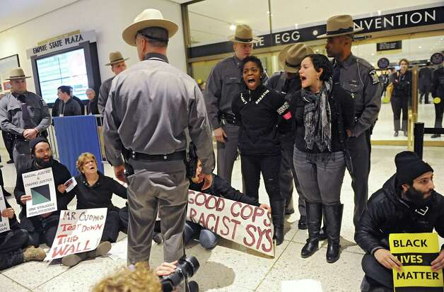 Protestors are arrested for blocking the entrance to Governor Andrew Cuomo's State of the State address in the Convention Center at the Empire State Plaza on Wednesday, Jan. 21, 2015 in Albany, N.Y. Most of the protestors were chanting about police brutality against black people. (Lori Van Buren / Times Union) Photo: Lori Van Buren / 00030240A