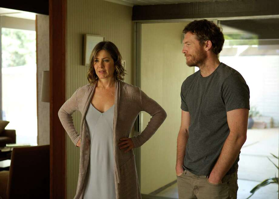 "This image released by Cinelou Films shows Jennifer Aniston, left, and Sam Worthington in a scene from ""Cake.""  (AP Photo/Cinelou Films, Tony Rivetti Jr.) ORG XMIT: CAET461 Photo: Tony Rivetti Jr. / Cinelou Films"