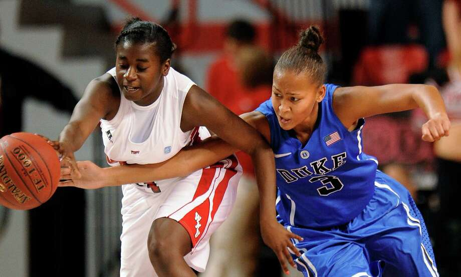 Western Kentucky guard Alexis Govan (left) has the ball stolen by Duke guard Shay Selby during the first half of a game in 2011. Photo: Joe Imel /Associated Press / FR49598 AP