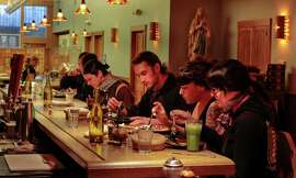 Diners enjoy happy hour at Gracias Madre, a vegan Mexican restaurant in the Mission District.