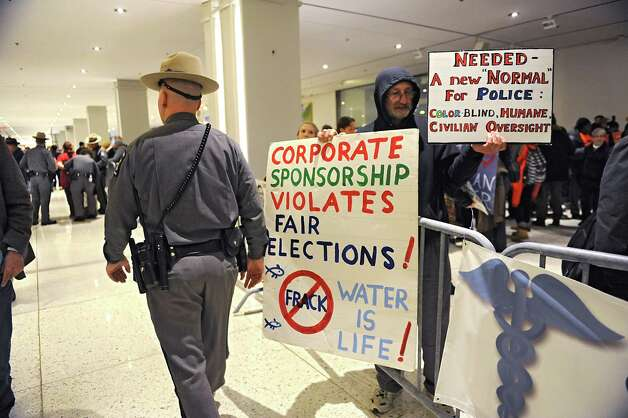 Protestors are kept behind barriers outside the entrance to Governor Andrew Cuomo's State of the State address event in the Convention Center at the Empire State Plaza on Wednesday, Jan. 21, 2015 in Albany, N.Y. (Lori Van Buren / Times Union) Photo: Lori Van Buren / 00030240A