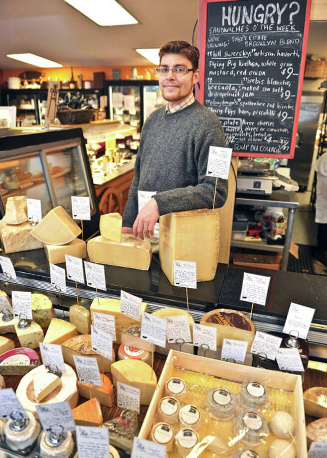 Eric Paul at the cheese counter of his store,  The Cheese Traveler in Albany, NY. Photo: John Carl D'Annibale/518Life / 00029746A