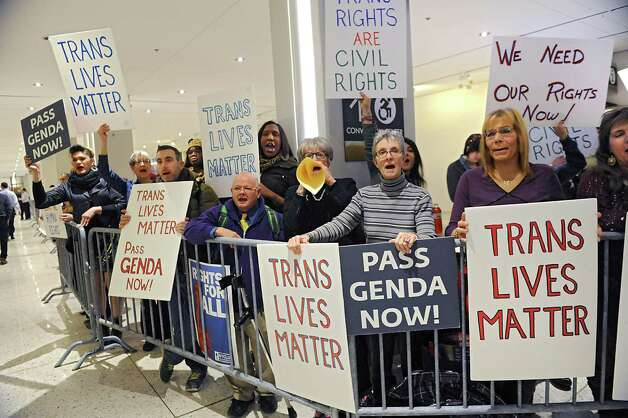 Protestors for transgender rights are kept behind barriers outside the entrance to Governor Andrew Cuomo's State of the State address event in the Convention Center at the Empire State Plaza on Wednesday, Jan. 21, 2015 in Albany, N.Y. (Lori Van Buren / Times Union) Photo: Lori Van Buren / 00030240A