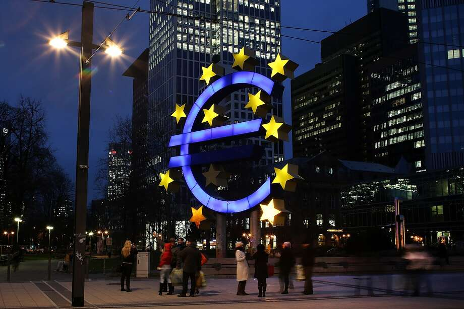A symbol of the euro is illuminated in Frankfurt, Germany. Photo: Hannelore Foerster, Getty Images